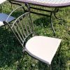 Karfa nélküli fém kerti szék párnával